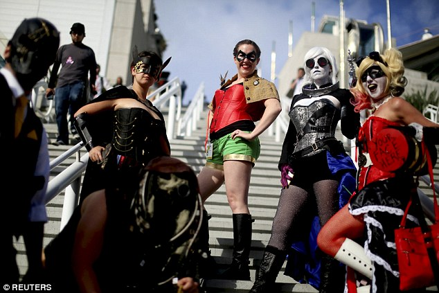 Girl power: A group of women show off their impressive cosplay before heading into the convention on Thursday