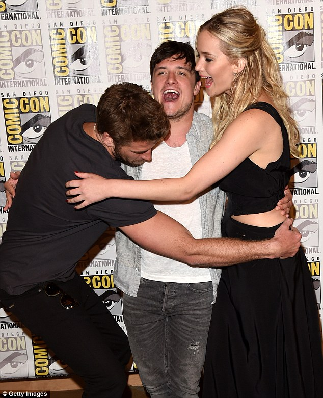 Hugging it out: Jlaw, Josh, and Liam appeared giddy while sharing a tender embrace