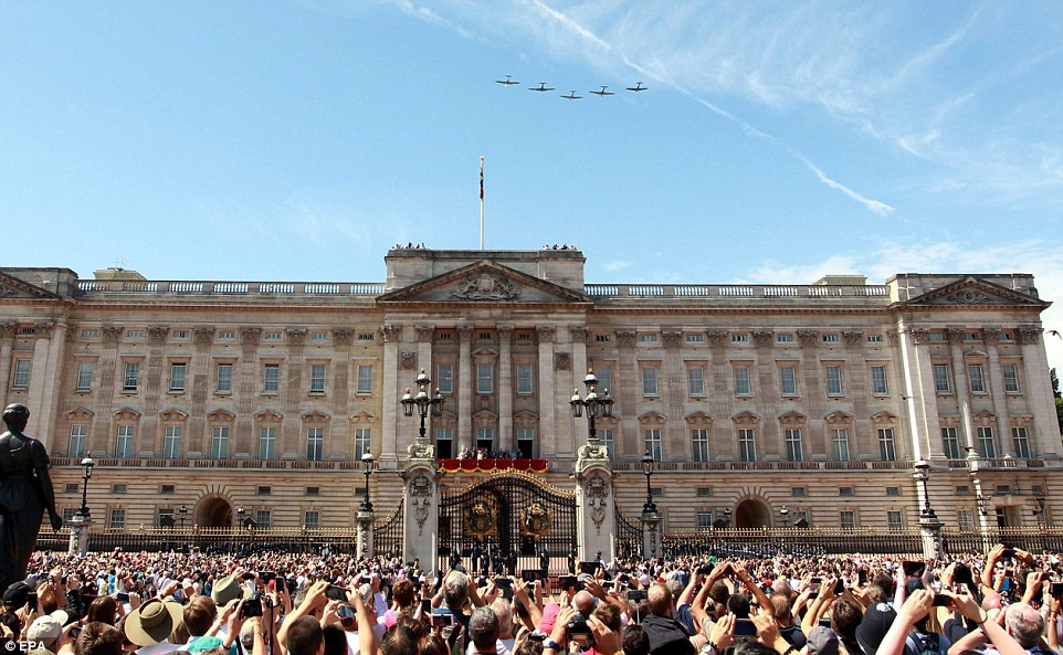 Hundreds gathered on the streets outside Buckingham Palace to watch two Hurricanes and three Spitfires flying in formation