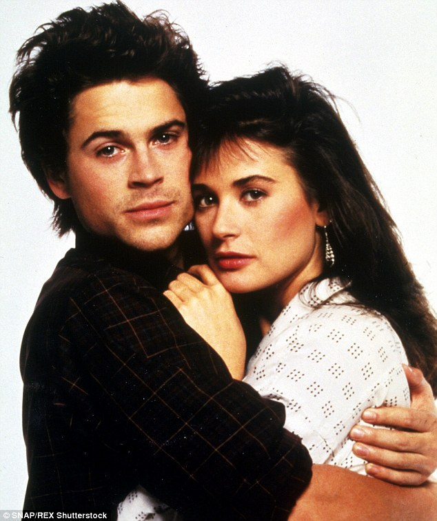 His pretty ex: Lowe famously dated Demi Moore and the pair starred together in two movies: St Elmo's Fire and About Last Night; here they are pictured in 1986