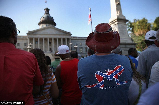 Some weren't so happy with the move and stood among the crowd decked out in Confederate merchandise
