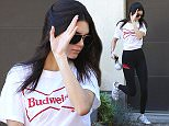 UK CLIENTS MUST CREDIT: AKM-GSI ONLY EXCLUSIVE: Beverly Hills, CA - Kendall Jenner is barefaced in Beverly Hills as she visits a residence. The international model wore black leggings and a Budweiser T-Shirt with Adidas Sneakers. Kendall turns 21 next November. She carried a cute pom pom key ring accessory as she walked back to her SUV.  Pictured: Kendall Jenner Ref: SPL1180748  181115   EXCLUSIVE Picture by: AKM-GSI / Splash News