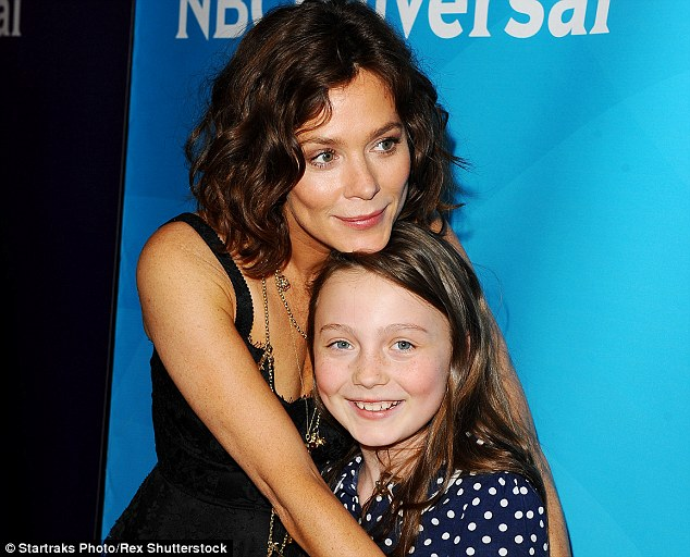 Gracie (pictured more recently with her mother) turned 10 yesterday and her parents, who dated for a decade, split in 2009