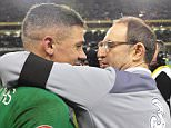 epa05028862 Ireland manager Martin O'Neill (R) celebrates with Jon Walters (L) after the UEFA EURO 2016 qualification playoff second leg soccer match between Ireland and Bosnia and Herzegovina in Dublin, Ireland, 16 November 2015. Ireland won 3-1 on aggregate to qualify for the UEFA EURO 2016.  EPA/AIDAN CRAWLEY