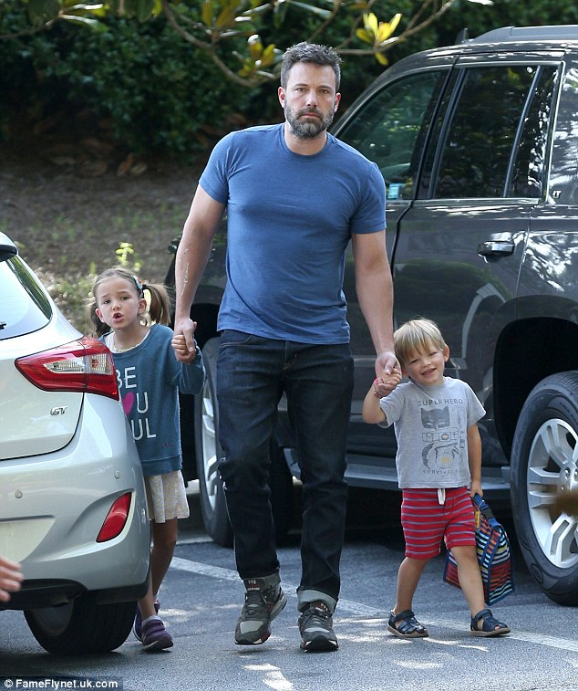 With the kids: Ben Affleck was spotted taking two of the children he had with soon-to-be ex-wife Jennifer Garner - daughter Seraphina, aged six, and son Samuel, aged three - out in Atlanta on Friday