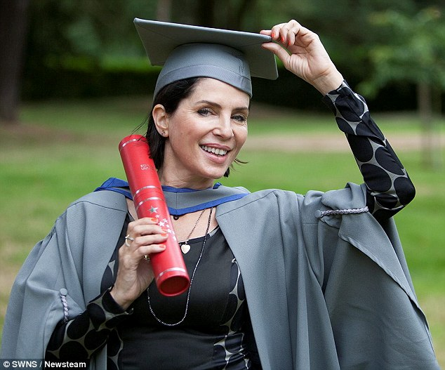 Hats off to me: The mother-of-four donned traditional academic dress for the happy occasion