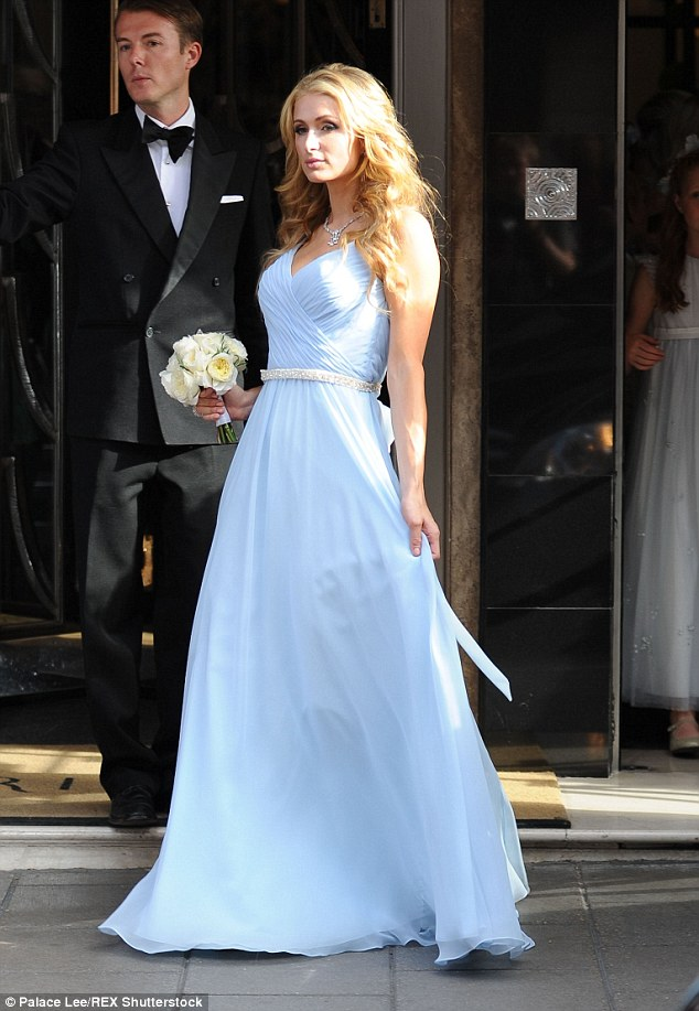 The paps are there: Nicky's older sister Paris Hilton (pictured) has already been photographed leaving for the ceremony