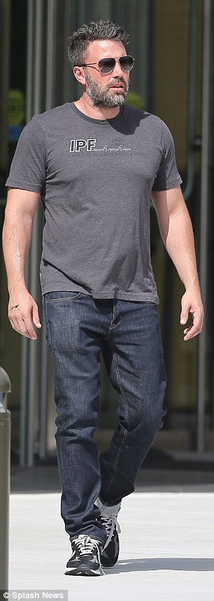 Low key: The Oscar winner was seen dressed in casual attire, wearing a tight black T-shirt and denim trousers