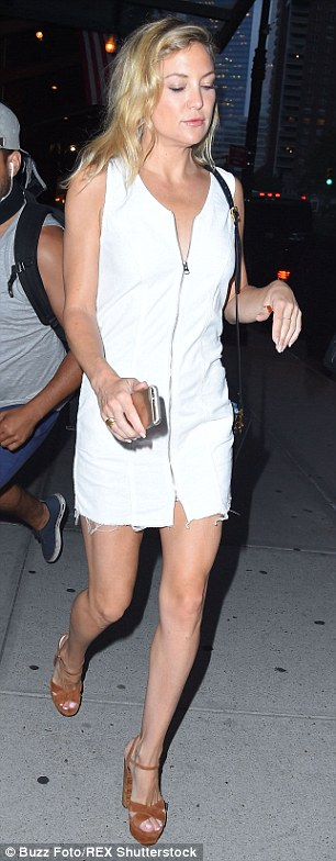 Boho babe: The blonde beauty paired her white hot denim dress with brown suede platform sandals