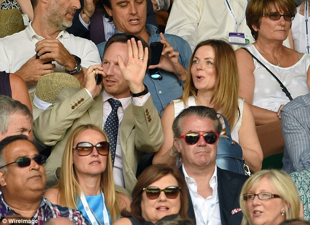 Spotted: The Red Bull Formula One boss waved at a friend in the crowd, while Geri grinned alongside him