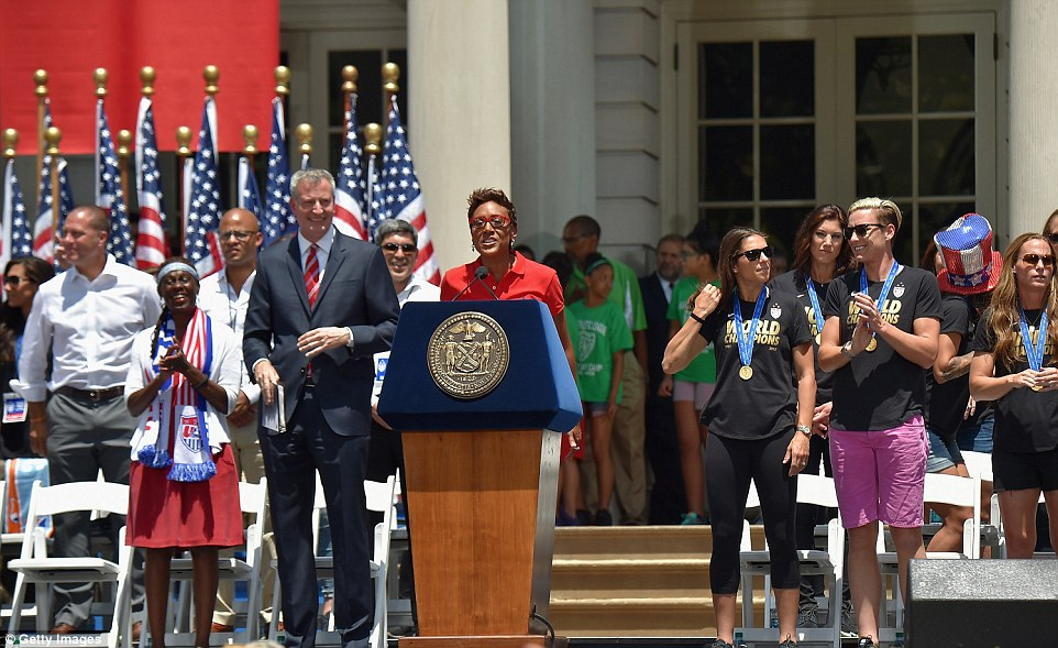 Robin Roberts (at the podium) was the voice of the women's ticker-tape parade and she said it was a 'drop-the-mic moment' for her
