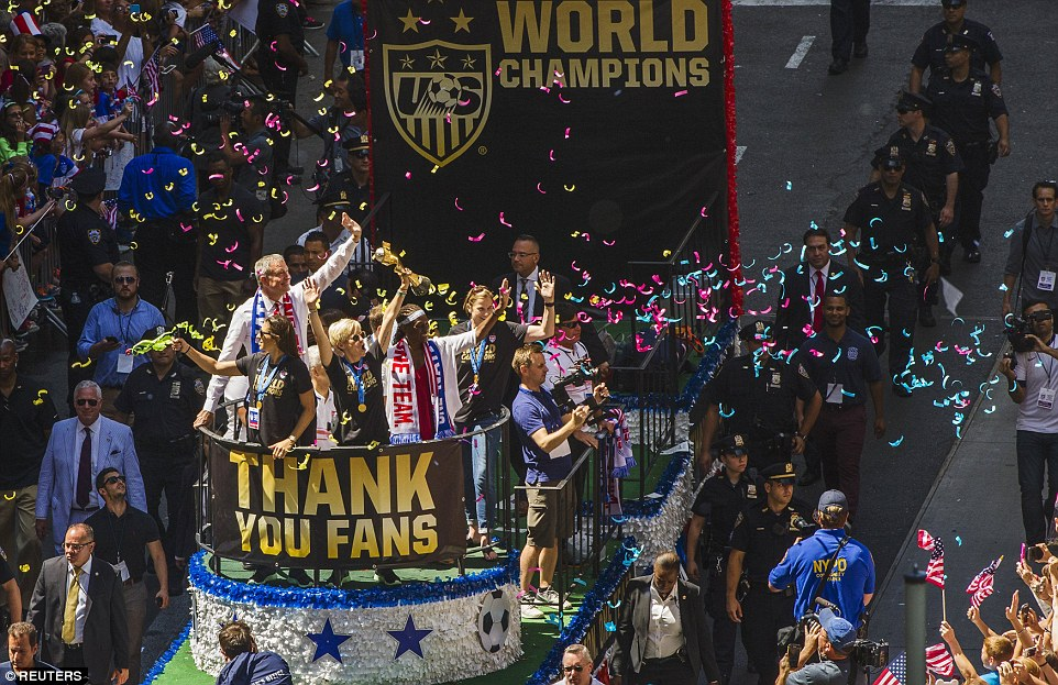 Lloyd, Rapinoe, McCray and coach Ellis (left to right) at the parade rolled happily on a float withMayor de Blasio (behindLloyd)