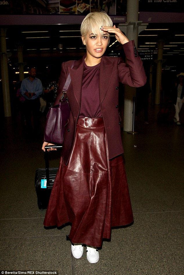 Welcome home! Rita Ora didn't look tired as she returned to London after a week of heading back and forth between