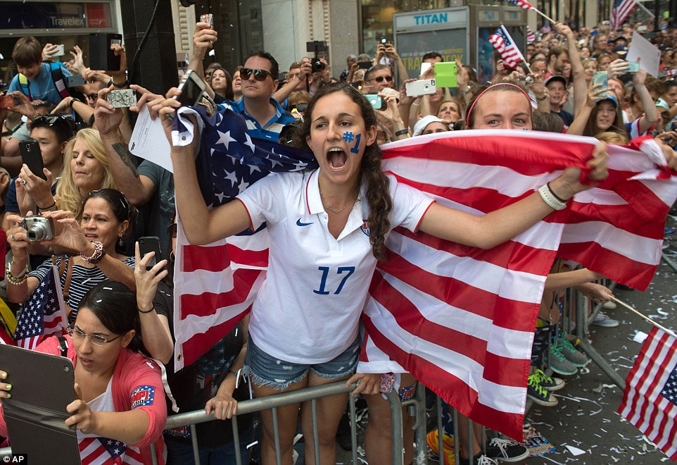 Lucie Keleman of New York's Westchester County (No 17) cheered as the procession honoring the champions rolled past