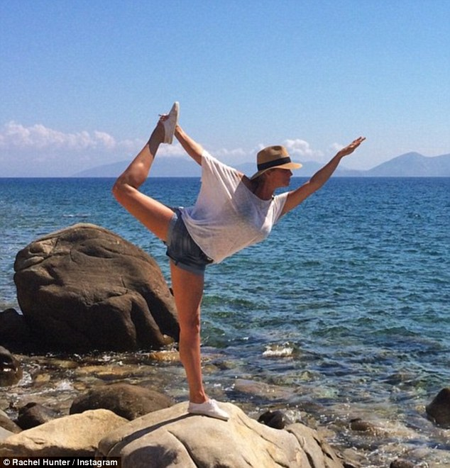 Dancer's pose! The age-defying beauty stays in great shape doing yoga