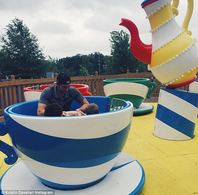 Oh what fun: Jay went on the teacups ride with son Camden, two, and his cousin. The couple are also parents to 13-month-old Jaxon