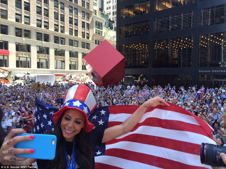 Dwyer took a selfie with an American flag in the background as the parade rolled up Broadway on its way to City Hall