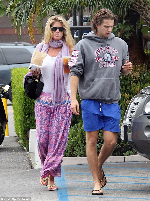 Relaxed vibe: The blonde ex-wife of Rod Stewart eschewed a hippy chic vibe for the outing dressed in a cotton white vest top and paisley patterned lilac and pink pants