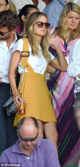 On their way: The loved-up pair head off after watching the Djokovic match