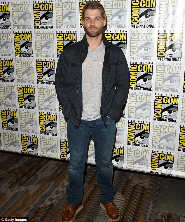 Casual cool:Mike rocked a denim jacket over a grey top, baggy blue jeans and Red Wing leather moc boots