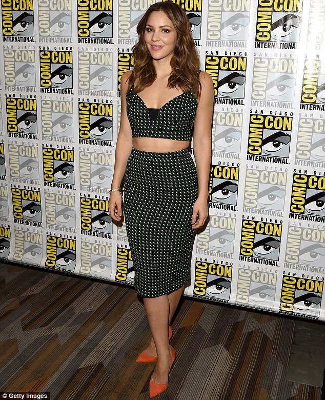 Toned tum: She bared her midriff in the dress as she teamed the look with orange suede heels