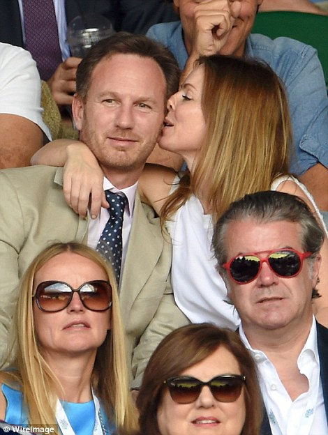 Love-d up: The married couple happily indulged in a few cheeky smooches and also took selfies at the match