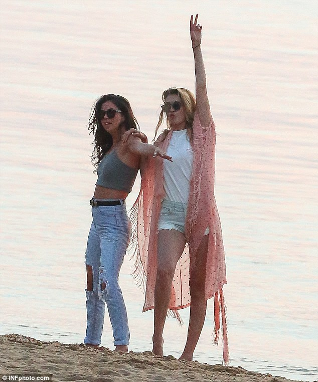 Down-time: Earlier this week Gigi enjoyed some relaxed time on the beach on Shelter Island, NY, with her friends she refers to as her 'summer crew' - including pals Leah (pictured), Cully Smoller and Samuel Krost