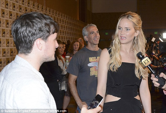 Little tease: Jennifer looked slightly unimpressed when Josh quizzed her about something