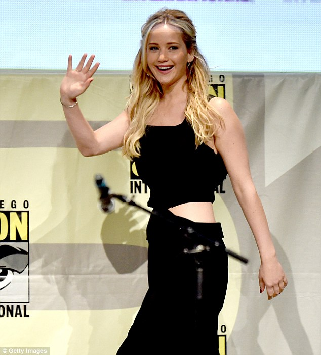 Such a tease: The 24-year-old actress looked absolutely sensational in a sexy black cut-out gown which flashed her toned midriff