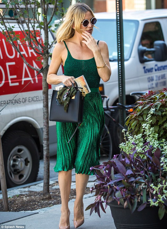 Green goddess: Kate Hudson glowed in an evergreen ensemble as she headed to lunch in New York City Friday