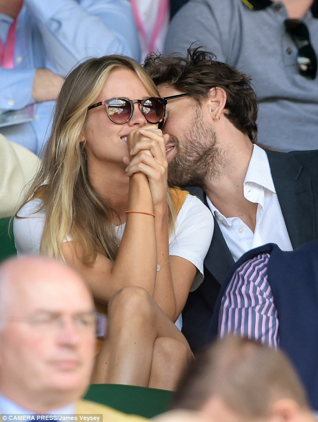 Mr Holcroft looked like he was trying to distract her as Cressida tried to keep her eyes on the tennis