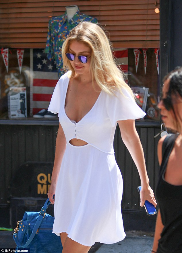 Summery: The 20-year-old model and socialite flashed her abs as she stepped out in Soho