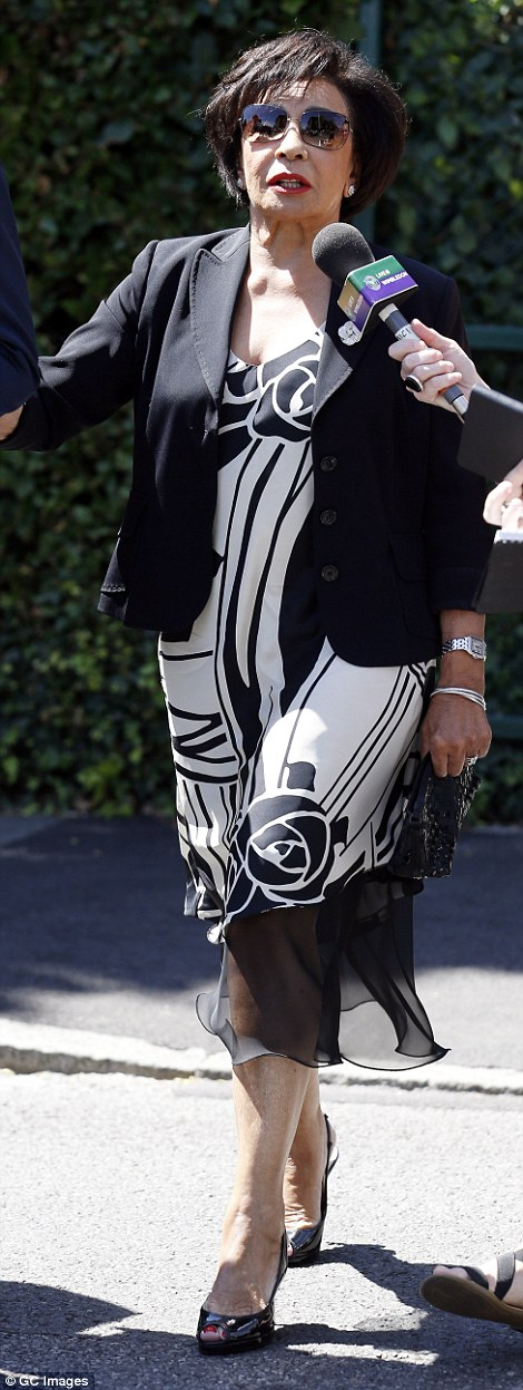 Monochrome chic: The 78-year-old singer oozed glamour in an art-deco inspired black and white dress and matching peep-toe heels