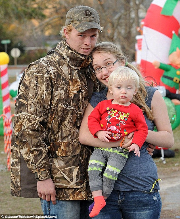 Lawsuit: Anna 'Chickadee' Cardwell, seen here with husband Michael and daughter Kaitlyn, two, has filed a claim against her mother Mama June Shannon for money she claims she and Kaitlyn are owed