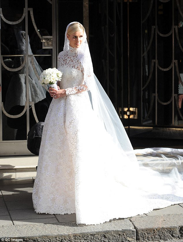 Blushing bride: Nicky Hilton, 31, donned a $77,000 couture Valentino gown featuring a high-neck and a long train on Friday when she wedbillionaire banking heir James Rothschild, 31, atKensington Palace