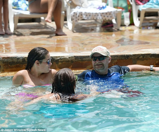 Rest and relaxation: Sugar Bear took it easy as he chatted to his step-daughter Jessica and her pal