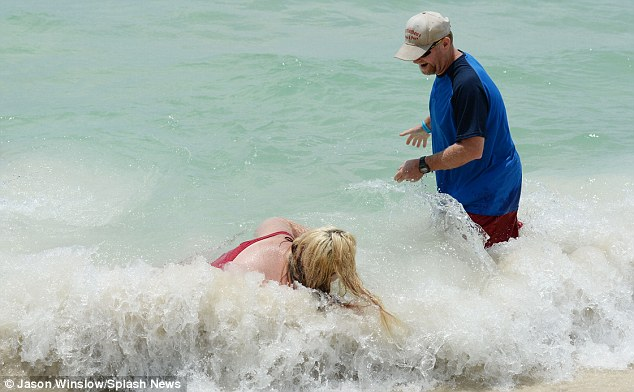 Onslaught: The mother-of-four got soaked as she lay stricken on the ground