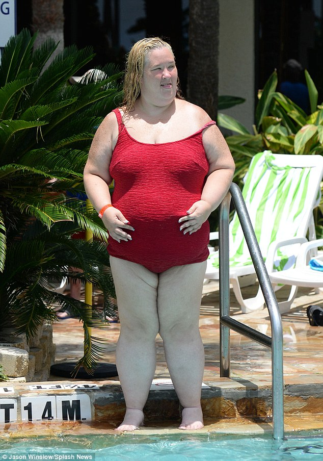 Risque: The famous matriarch almost suffered a wardrobe malfunction as one strap of her swimsuit slipped off her shoulder