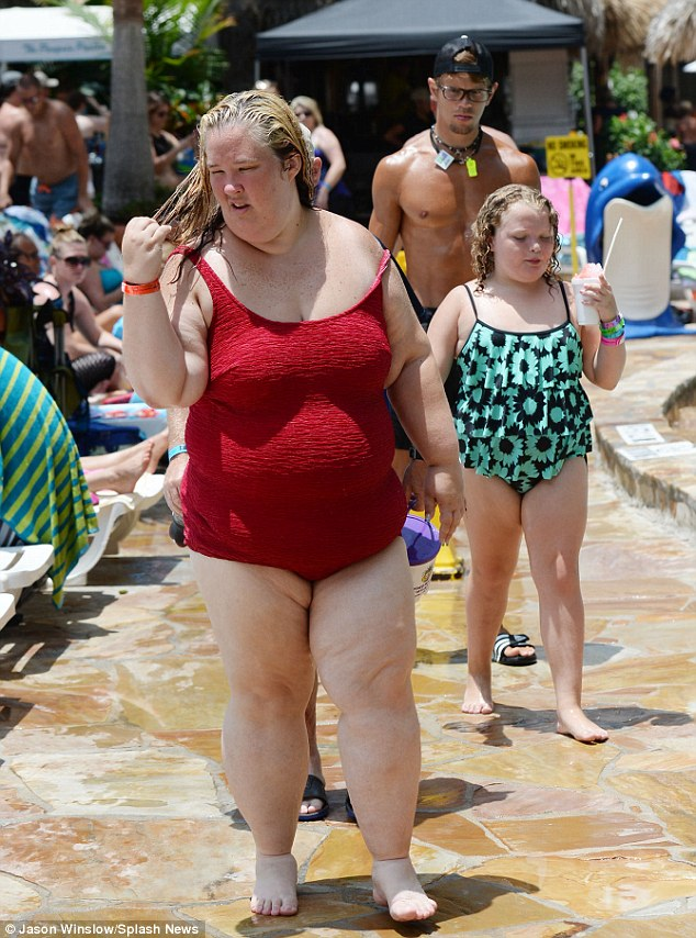 Taking it easy: June and her pageant princess took a stroll around the pool