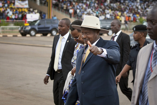 FILE - In this Monday, March 31, 2014 file photo Uganda's President Yoweri Museveni arrives at an anti-gay rally organized by a coalition of Ugandan religiou...