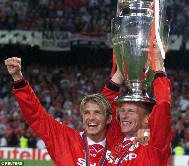 Beckham celebrates with Teddy Sheringham after United win the Champions League in 1999
