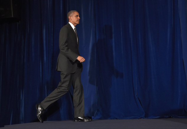President Barack Obama arrives for a news conference in Kuala Lumpur, Malaysia, Sunday, Nov. 22, 2015. In Southeast Asia, Obama has taken a softer tone on hu...