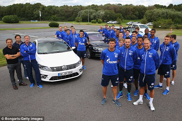 Schalke, another club sponsored by players pose with Volkswagen cars during a test drive day out last year
