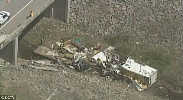 The Kansas Highway Patrol said the Freightliner motor home was carrying 18 people, both adults and children, and pulling a trailer when the driver lost control