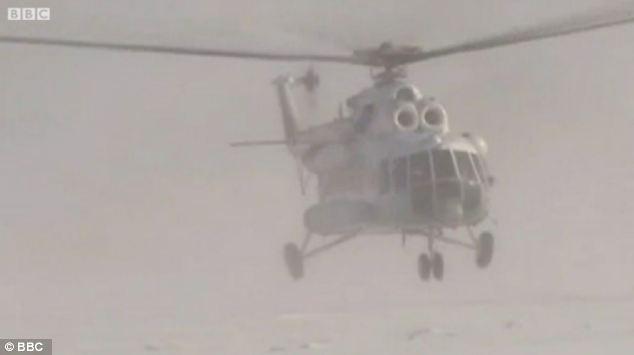 A chopper arrives as part of teh operation to airlift the Russian fisherman to safety