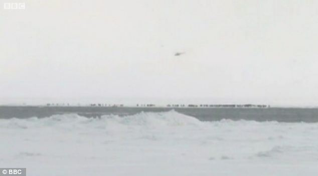 Stranded: The fishermen were stuck for around six hours in the freezing conditions before the emergency services arrived