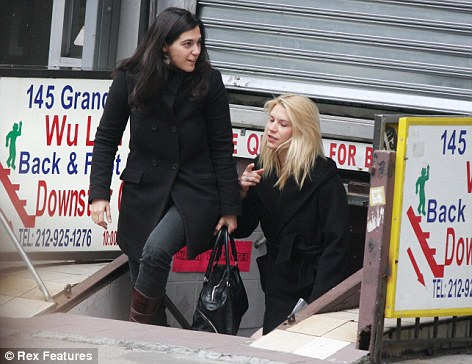 Blissed out: Claire Danes emerged from an underground massage parlour in NYC with her eyes closed