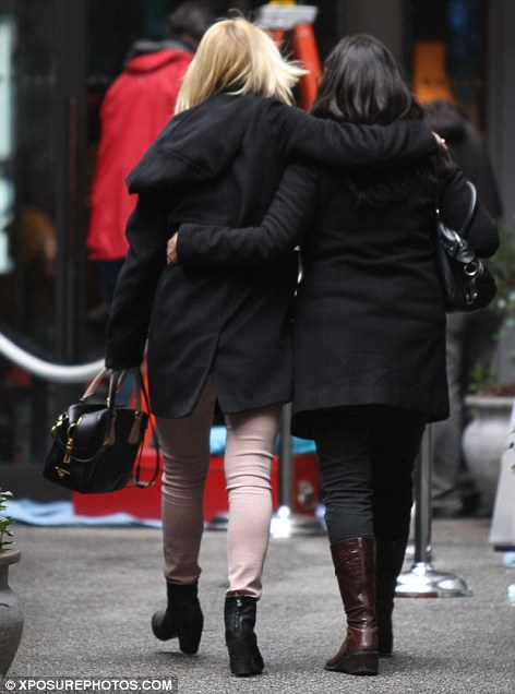 Real friends: Claire and her pal walked with their arms wrapped around one another