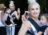 EXCLUSIVE: **PREMIUM EXCLUSIVE RATES APPLY** Gwen Stefani facetimes Blake Shelton while on a trip to Huntington Gardens in Pasadena, CA\n\nRef: SPL1171198  221115   EXCLUSIVE\nPicture by: Splash News\n\nSplash News and Pictures\nLos Angeles: 310-821-2666\nNew York: 212-619-2666\nLondon: 870-934-2666\nphotodesk@splashnews.com\n
