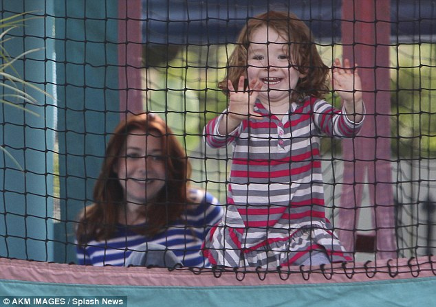 Jump Jump: Alyson Hannigan and her daughter made merry in a house of fun at their Brentwood home yesterday